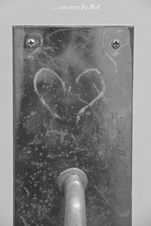 Filthy door handle , yes.  but I just had to capture the heart scribed above it.